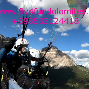 How to make co-workers happy? But with a nice evening two-seater flight over the Val di Fassa and the Dolomites!