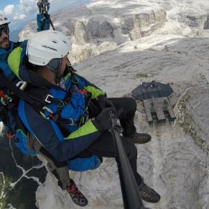 View of the Sass Pordoi cable car in Val di Fassa, tandem paragliding flight