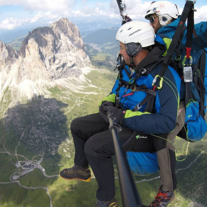 View of the Sassolungo in Val di Fassa, tandem paragliding flight