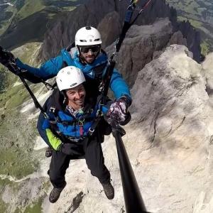 View of the Sella in Val di Fassa, tandem paragliding flight