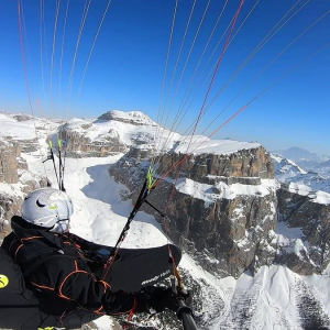 The flight in winter. Unforgettable landscapes. Here we are above the Sassolungo, Sella and Pordoi in Val di Fassa