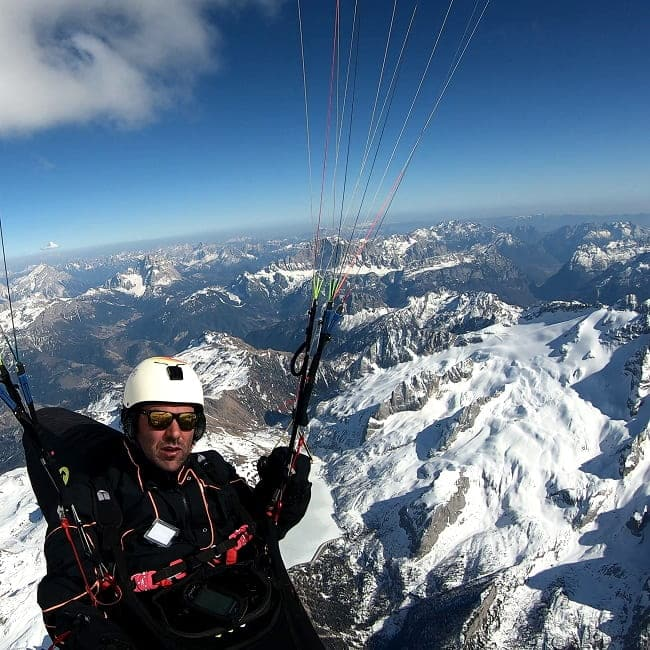 Gabriele paragliding at 4000 meters above the Val di Fassa